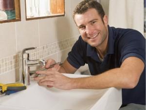 image of plumber in bathroom